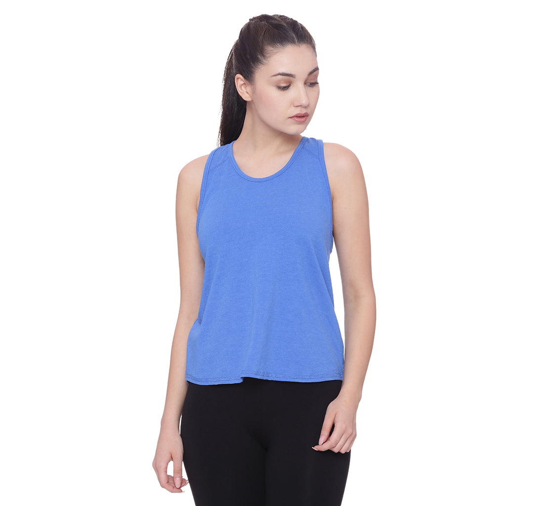A blue loose fitting tank top is worn by a model