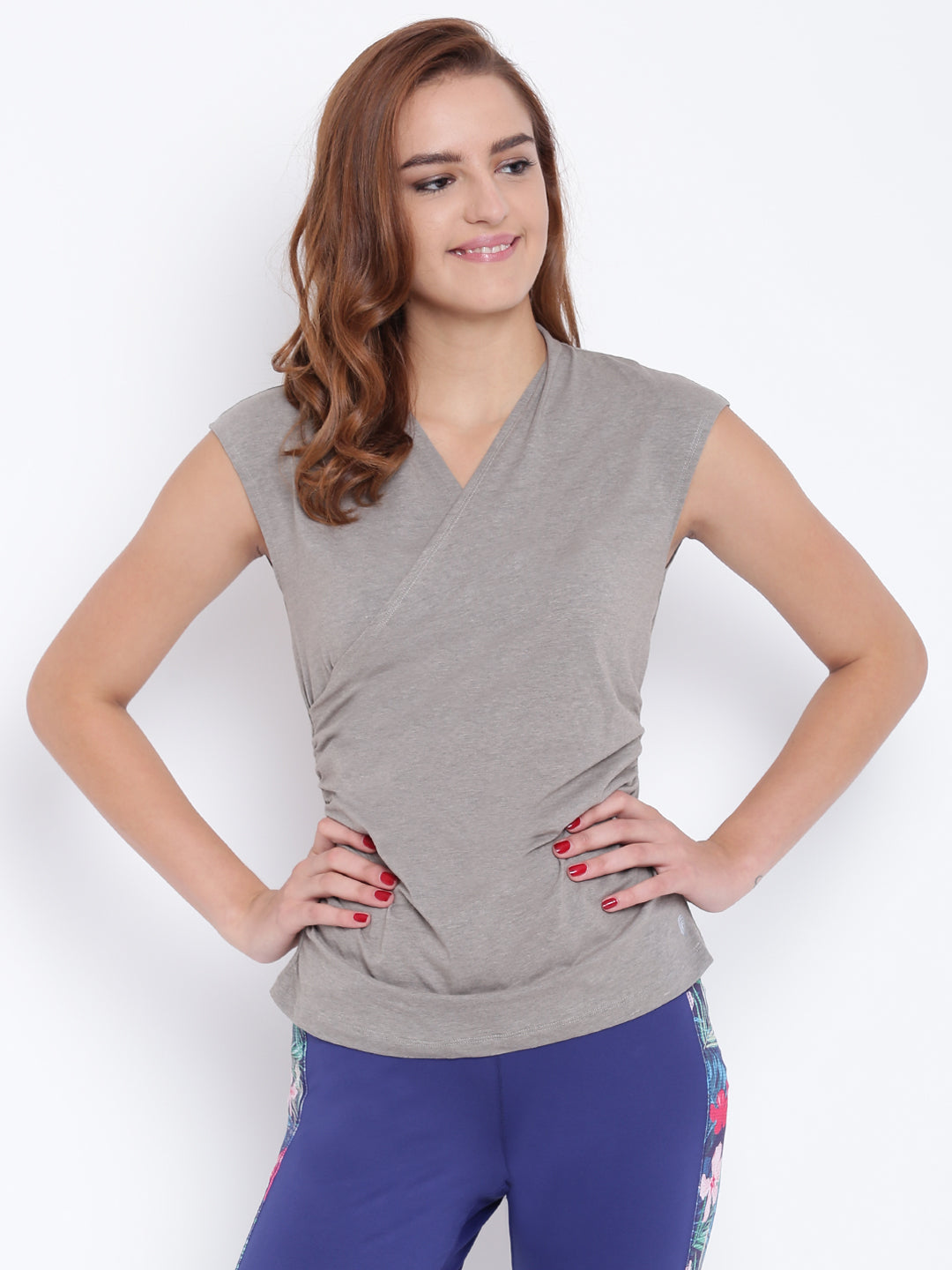 A model wearing a tan women's wrap top, Fairtrade Certified