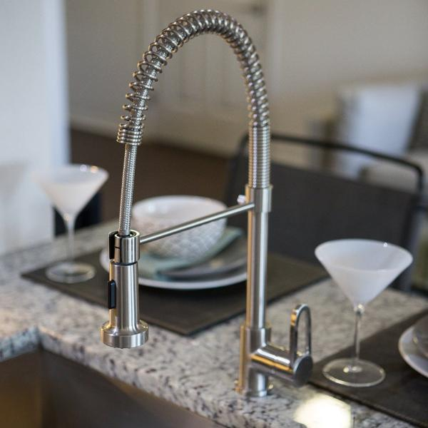 Pre-Rinse Kitchen Faucet - 19 Inch - Pull Down Sprayer - Single Handle installed on a breakfast bar