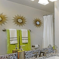 Towel Bar - 24 Inch - Steel - Wall Mounted installed in a bathroom, reflected in mirror