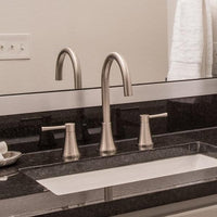High arc bathroom faucet on black marble countertop