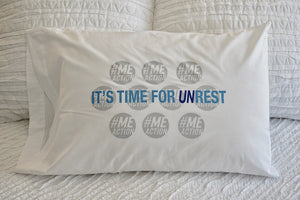 "White pillowcase with a white background. The pillowcase says ""It's time for UNRest"" in blue font in front of a pattern of gray #MEAction logos."