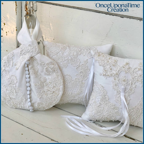 Pillow and Wristlet Bag Keepsakes made from a wedding dress by Once Upon a Time Creation