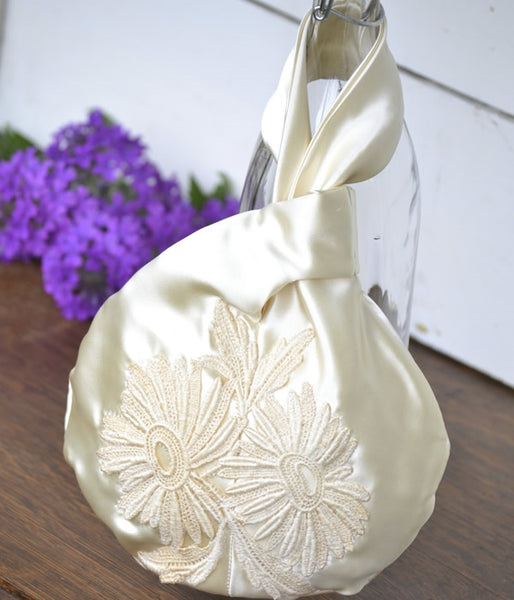 Custom wristlet evening bag made from a wedding dress by Once Upon a Time Creation