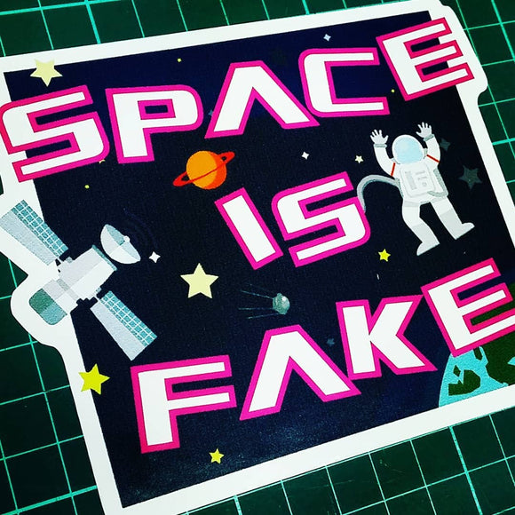 SPACE IS FAKE sticker.