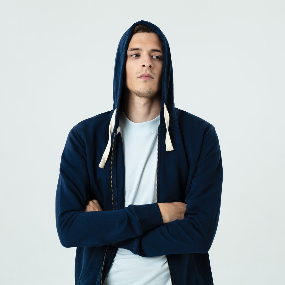 Luke - la base navy zipped hoodie in organic coton worn by Sebastien François like a thug