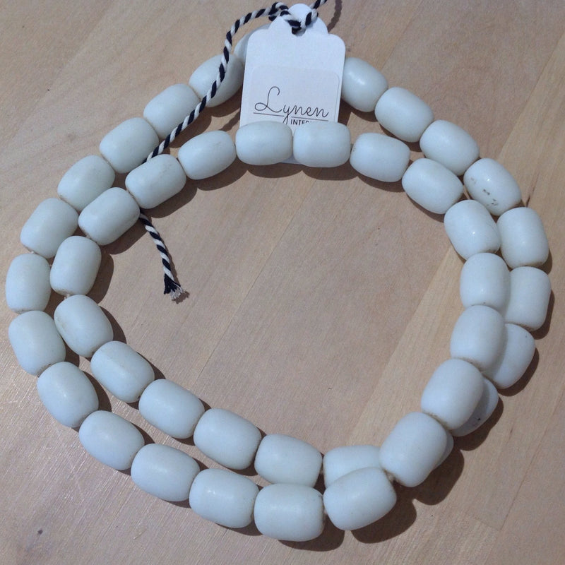 Hand made white colored recycled beads by master artisans.