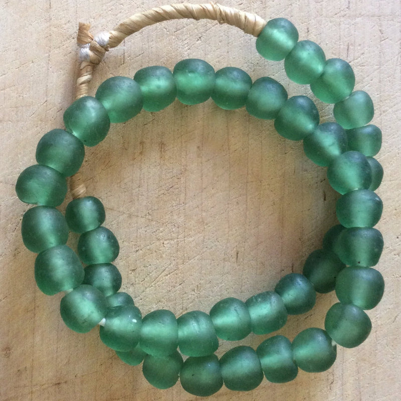 Hand made sage colored recycled beads by master artisans.