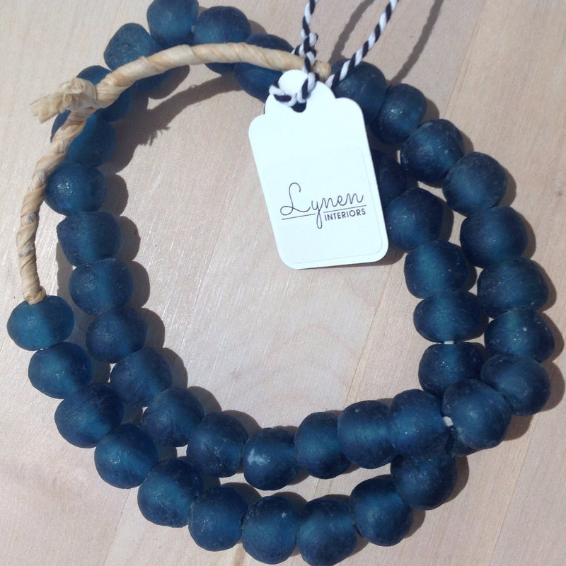 Hand made teal colored recycled beads by master artisans.