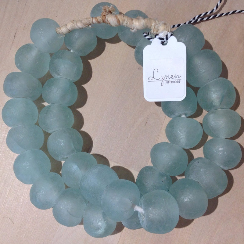 Hand made aqua colored recycled beads by master artisans.
