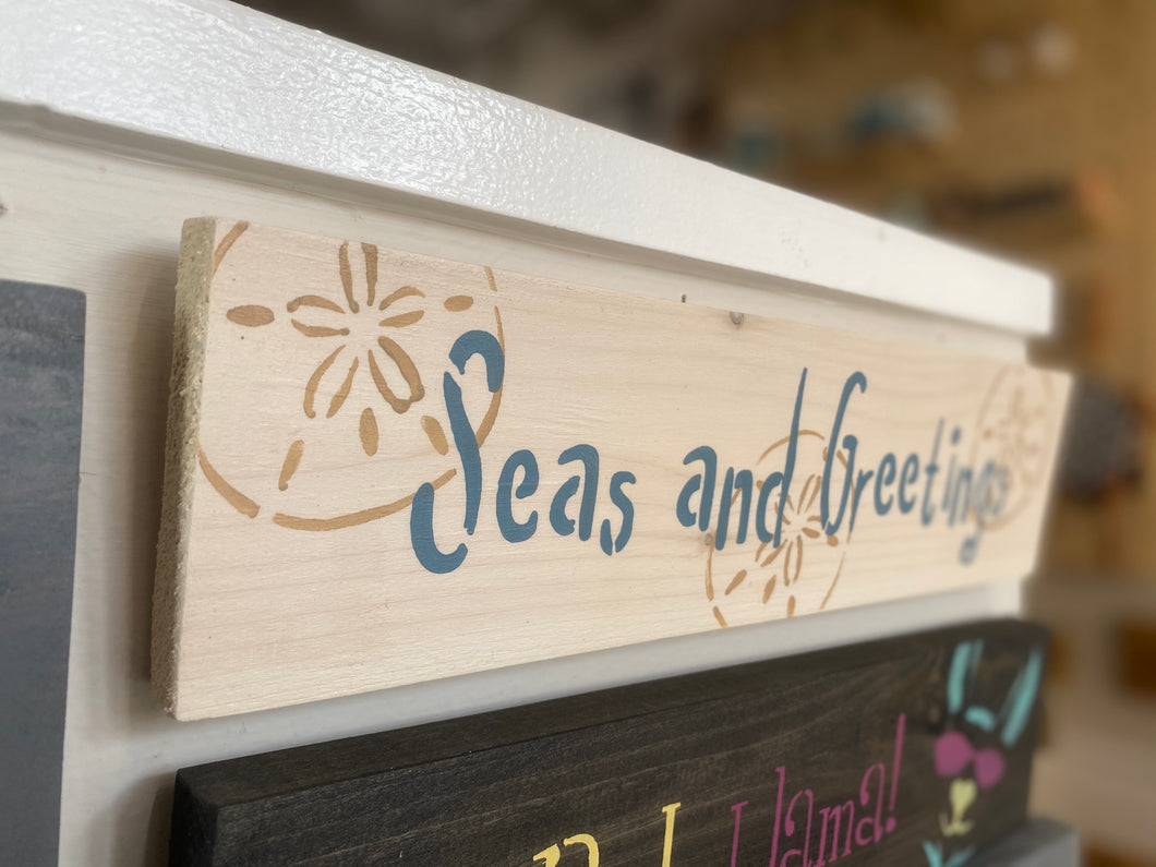 Seas and Greetings Sign