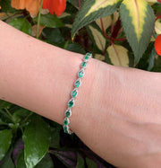 14KT White Gold Emerald and Diamond Tennis Bracelet