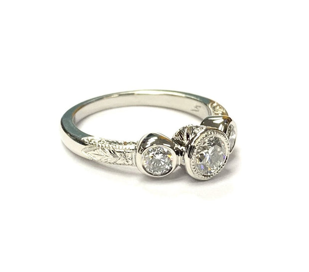 Platinum Engagement Ring With Bezel Set Diamonds & Fine Engraving