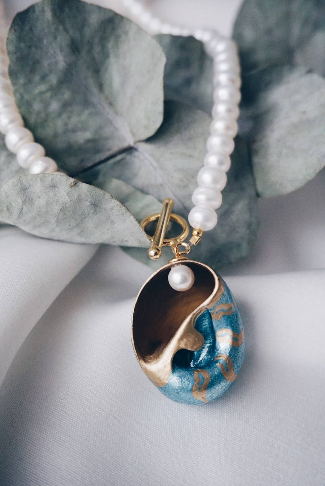 Emily sea snail necklace