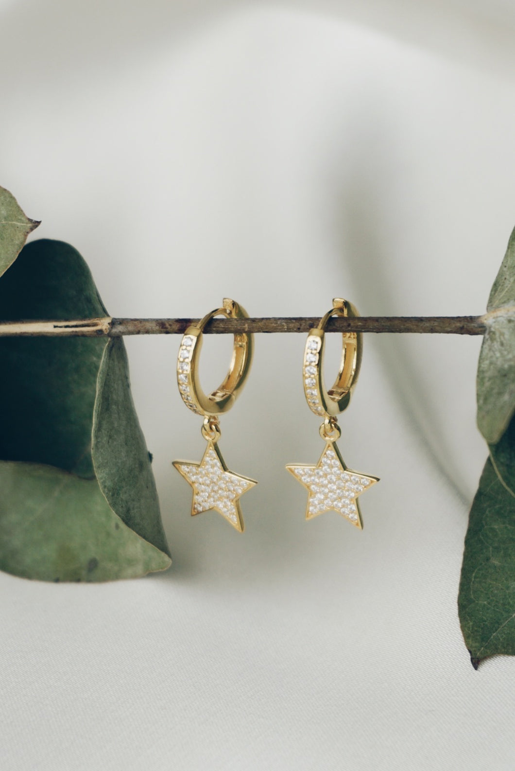 Double star hoop earrings
