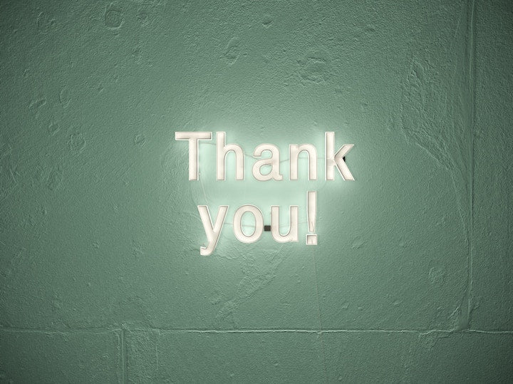 Thank you sign on wall with lights