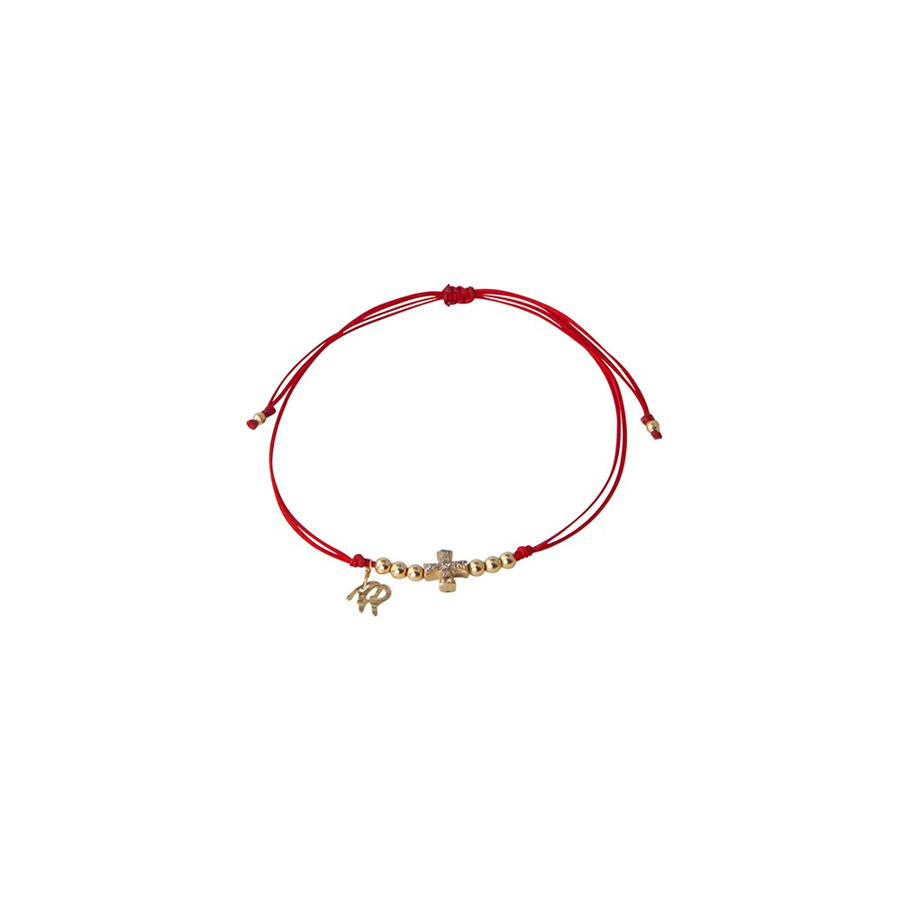 Red string bracelet featuring crisscross charm