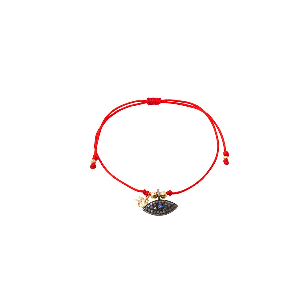 Red string bracelet with solitary silver God eye