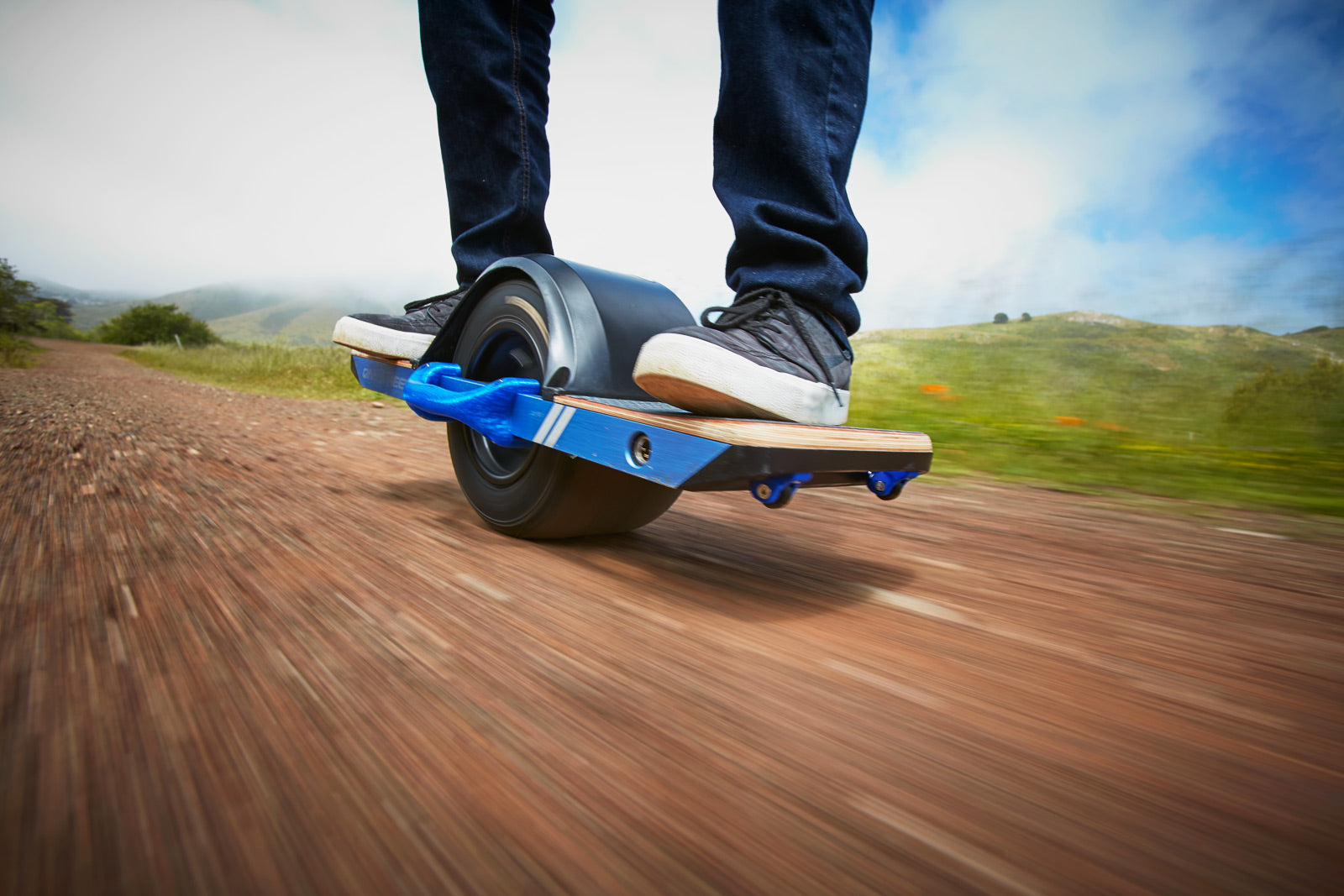 OneWheel outfitted with a tough Bone Flex™ handle and Fang Minis™