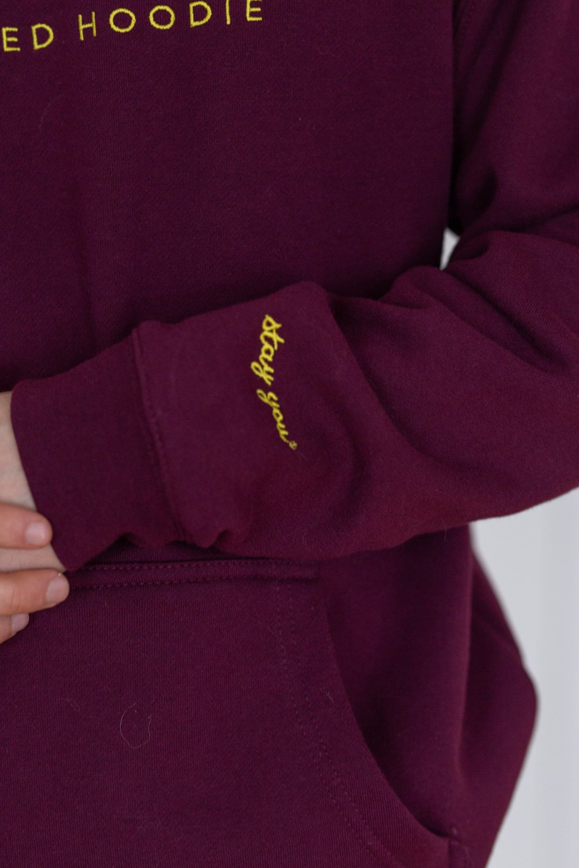 'Stressed Hoodie' in Crisp Red Wine, Embroidered in Vin Jaune Yellow Thread