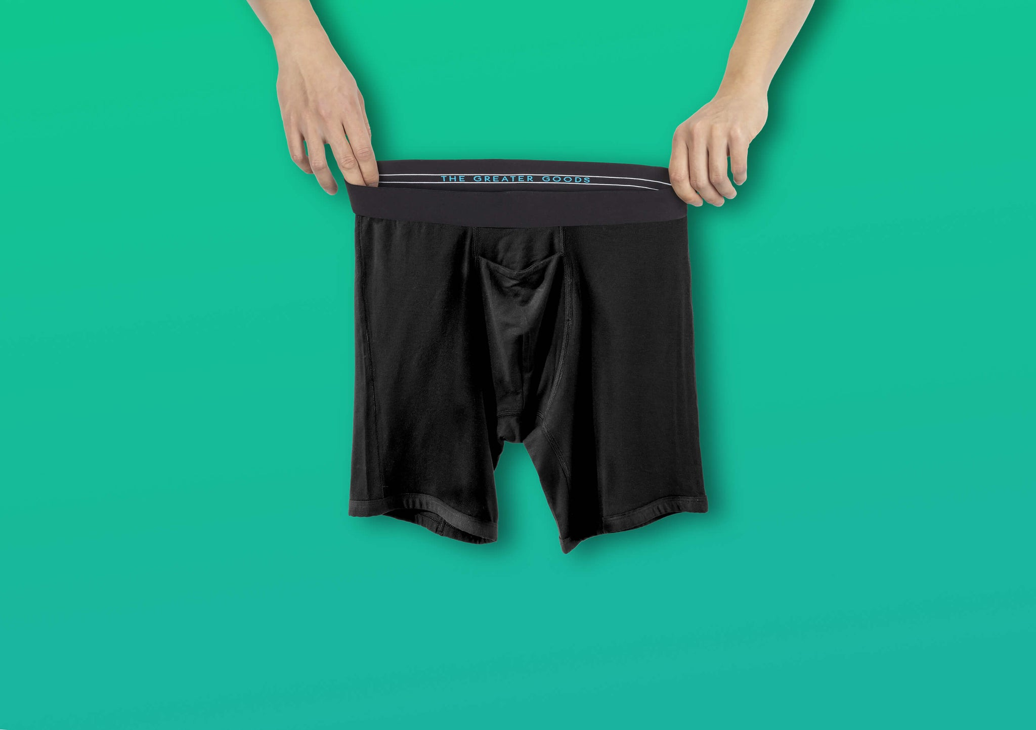 Man holding GoodFors, the best black boxer brief underwear, made of comfortable modal with a horizontal fly.