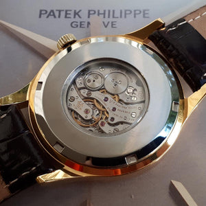 Patek Philippe - Custom World Time Watch - Yellow Gilted Gold - Cal. 177 Movement with Original Solid Gold Buckle