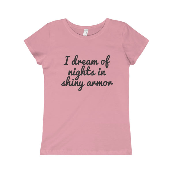 "Girls T Shirt in Pink. A very slim fitted shirt, it will instantly become an irreplaceable statement item. It has the words ""I dream of nights in shiny armor"" on the front in fun script.  Perfect for kids who love airstreams."