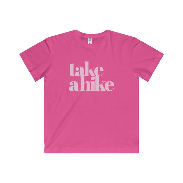 """Take a Hike"" is written in white on this Pink T Shirt for Kids.  Super soft fine jersey fabric compliments that playful innocence of this longer-length youth style tee. High quality print makes it instantly loved by all who wear it."