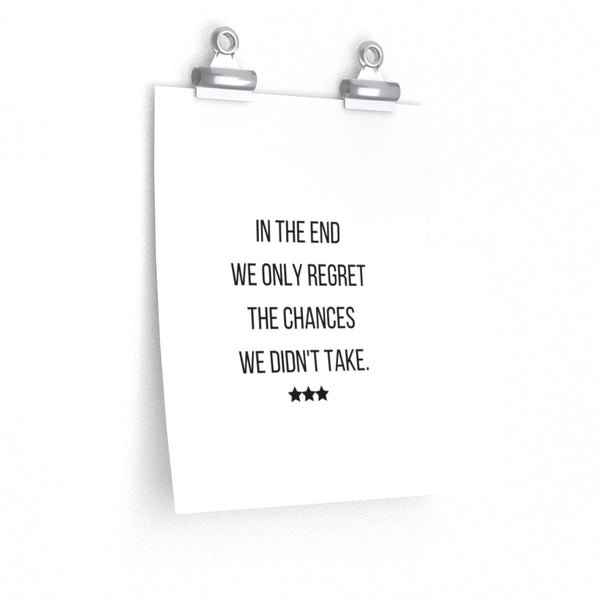 """in the end we only regret the chances we didn't take"" is written on a poster with block Font in black with 3 black stars below."