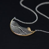 Hand crafted whale swimming in ocean necklace in 925 sterling silver