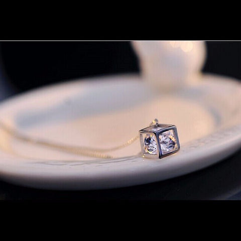 Diamond in cube pendant