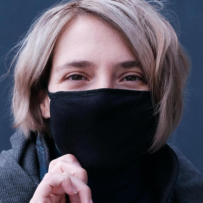 Close-up profile of a black cotton face mask on a blonde woman's face (4643759751273)