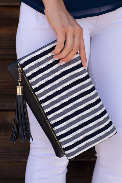 STRIPED CLUTCH WITH TASSEL DETAIL