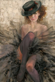 Ballerina wearing a top-black hat, and black tulle outfit.