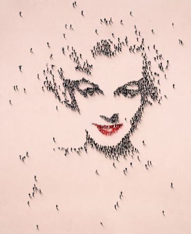 Miniature images of people forming a Marilyn Monroe facial form, with a coral color background.