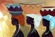 Three women carrying the symbolism custom decorative baskets on the their heads.