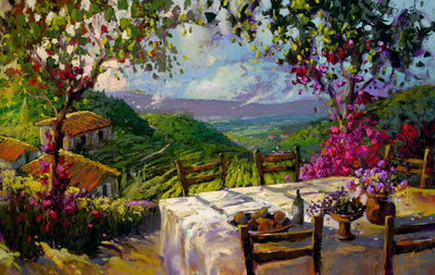 An inviting patio table and chairs over looking the Tuscany vineyard hills.