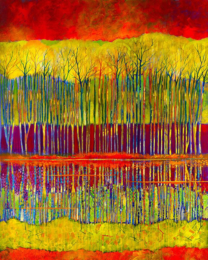 Bold colors in red and gold illuminate the trees reflection in the waterin