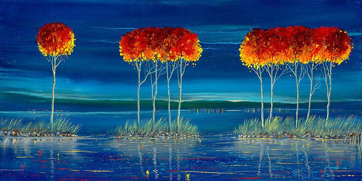 red topped treet on small islands of water over looking the blue sunset