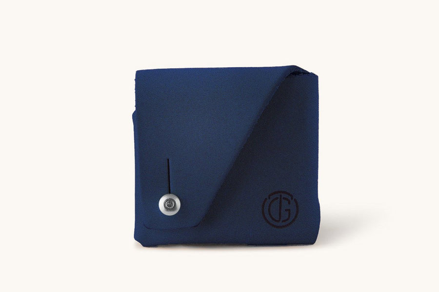Cobalt Blue Leather coin pouch with button and a monogrammed TG label.