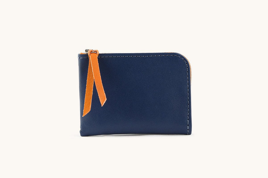 Navy blue zip wallet with leather zip pull.
