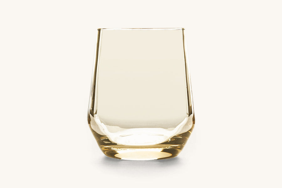 A wine glass with a honey color tint.