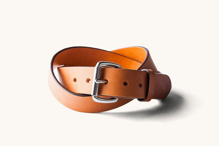 a tan coiled belt with a stainless buckle