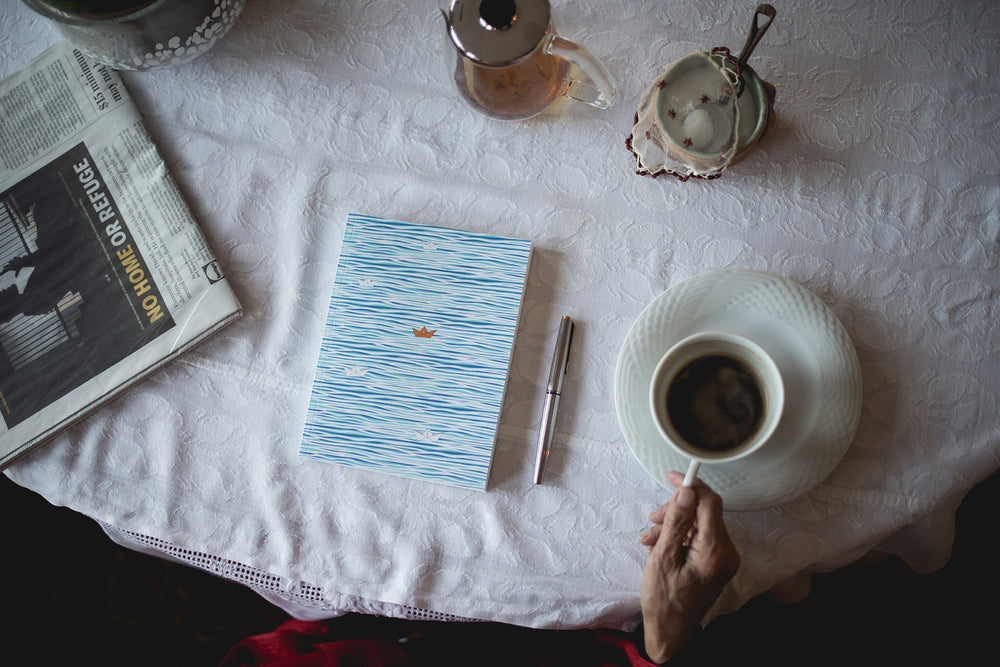 Water and boat cover personal journal. Tranquil notebook with summer ocean, water, boat scene. Blank, unlined notebook pages. 100% recycled paper. High quality paper notebook. An eco journal, perfect everyday journal