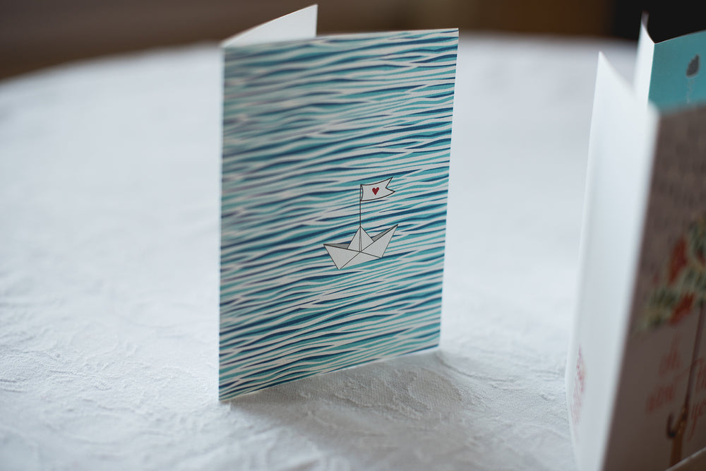 Water and boat greeting card. Peaceful summer ocean, water, boat scene. Paper boat with heart. Everyday greeting card, love card, thank you card. Blank inside, 100% recycled paper.