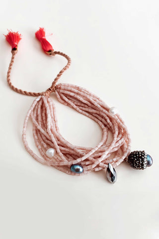 BOHO TASSEL BANGLE IN LIGHT PINK