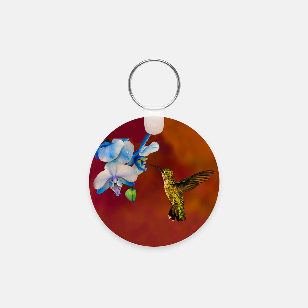 Blue Orchid Feast photograph printed on a round key chain.