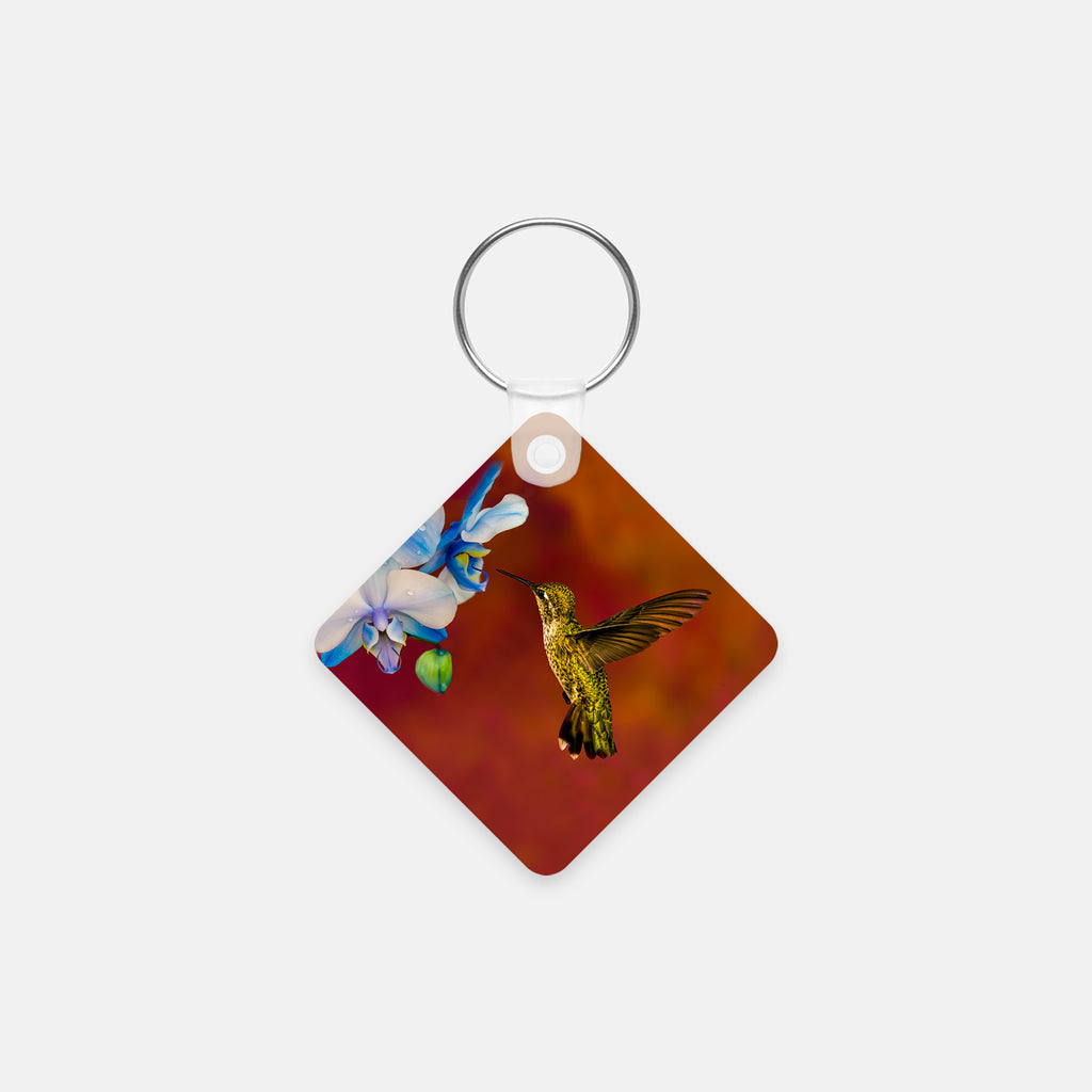 Blue Orchid Feast photograph printed on a square key chain.