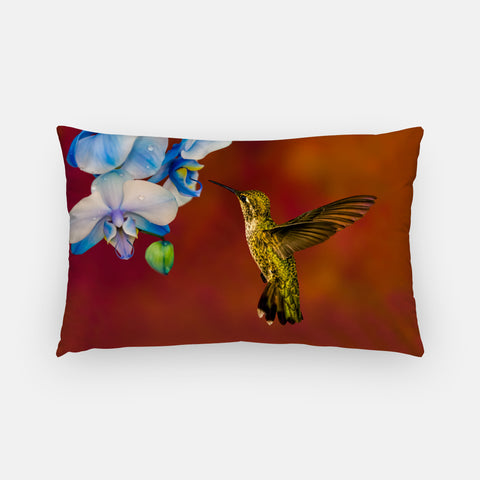 Blue Orchid Feast photograph printed on a lumbar pillow.