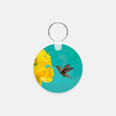 Daffodil photograph printed on a round key chain.
